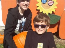 Mrs. Chaltraw's (cute) kids picking out pumpkins at Leaman's